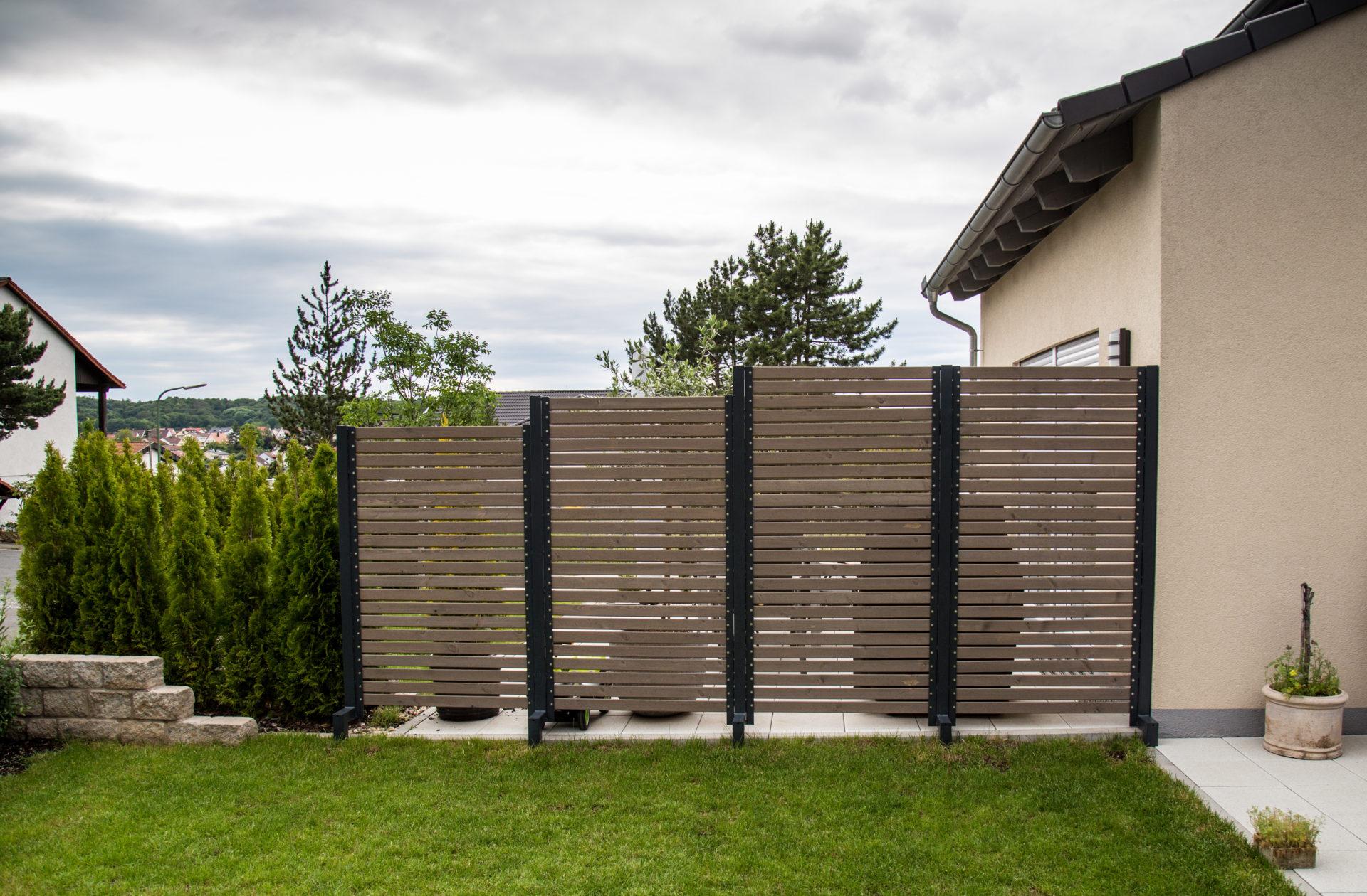 Sichtschutz Und Natursteinmauer Kaufmann Bauunternehmen Gmbh